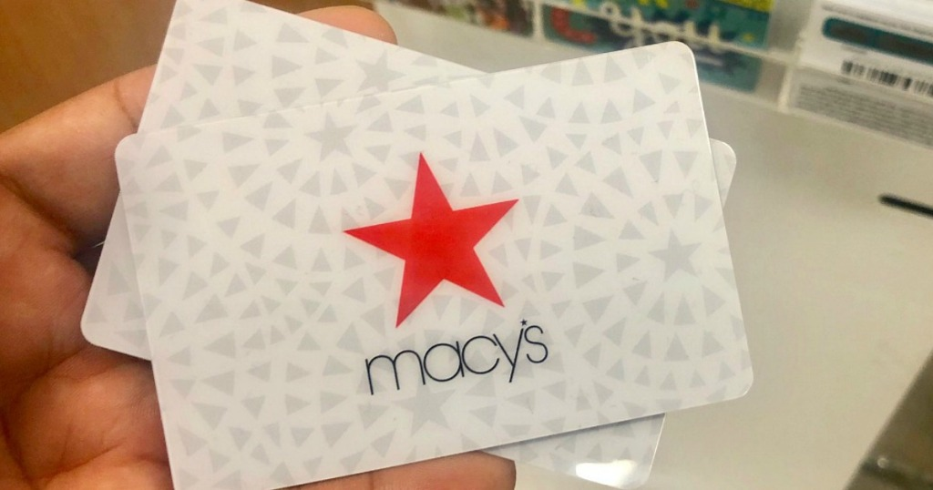 hand holding a Macy's gift card