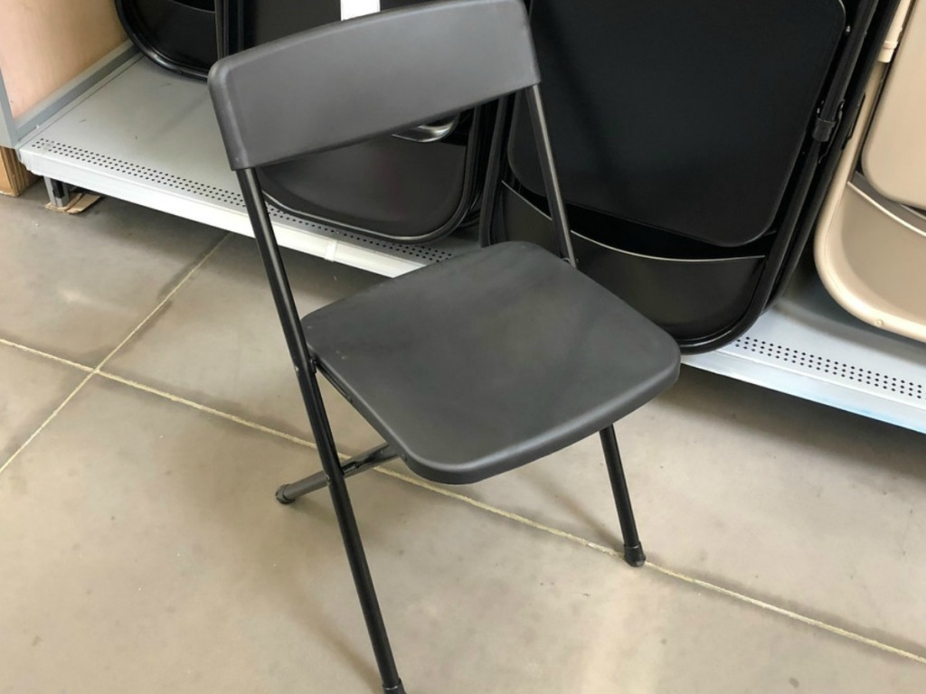 black folding chair by store display