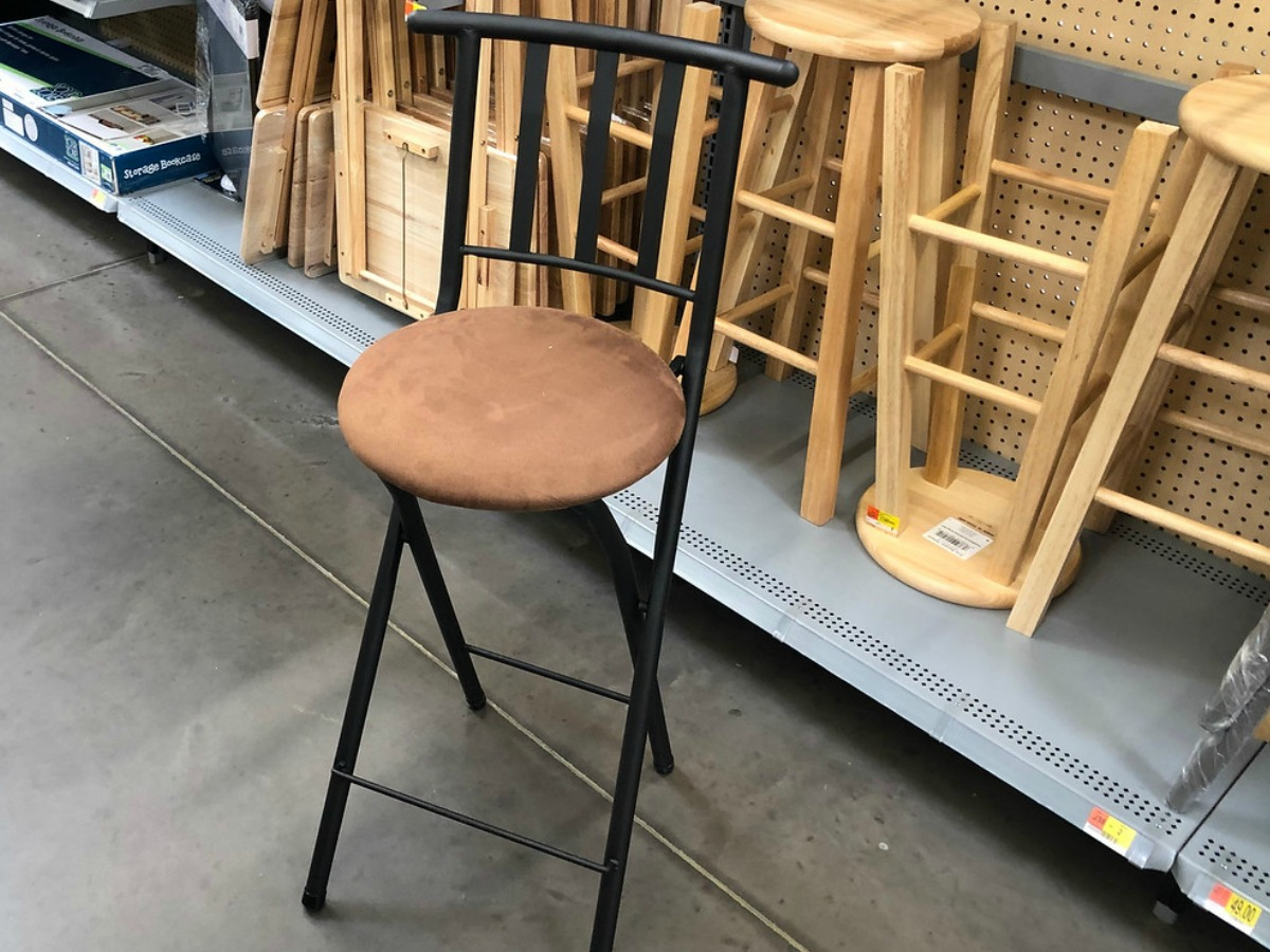 brown and black stool by store dislay in Walmart