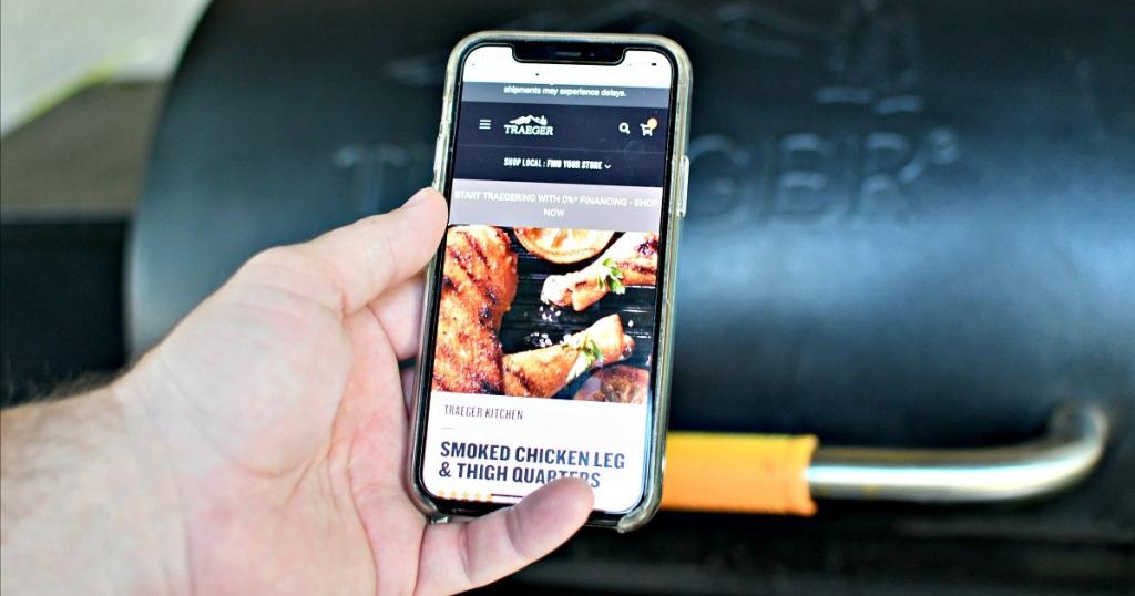 man holding the traeger app