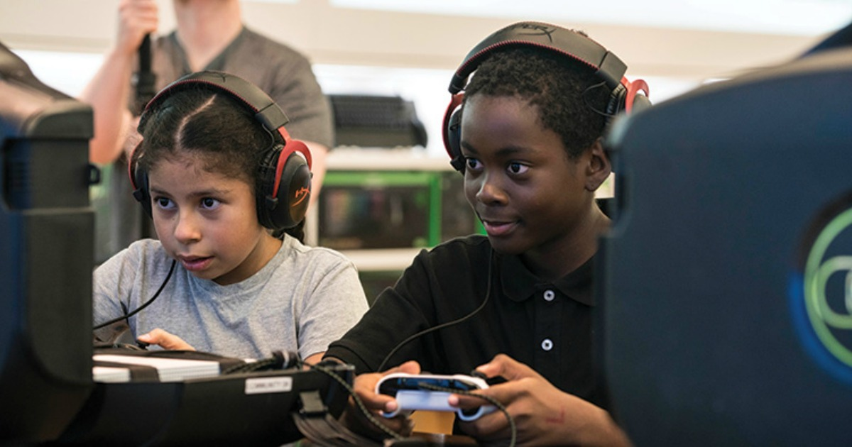 girl and boy playing video games with headphones on