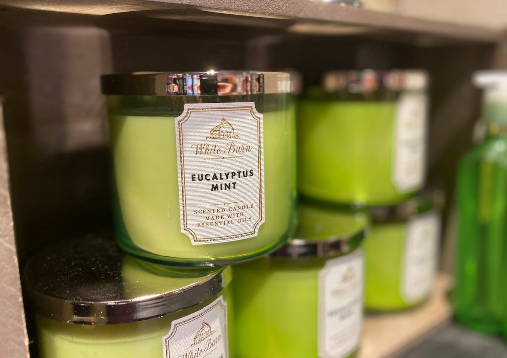 stack of green candles on store shelf