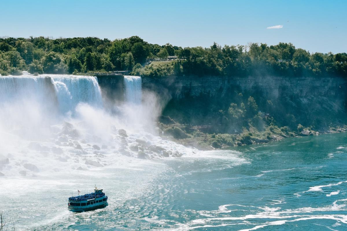 boat in water at the base of cheap family vacation spot niagara falls