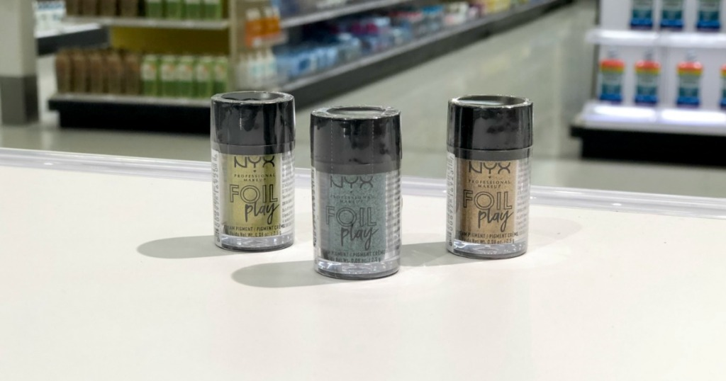 3 nyx foil play bottles on display on table at store