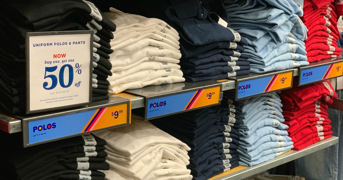 stacks of kids school uniform polo shirts on an old navy shelf