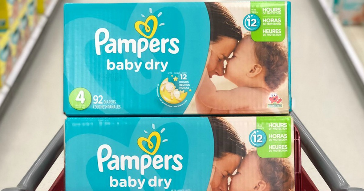 two boxs of pampers baby dry diapers in shopping cat