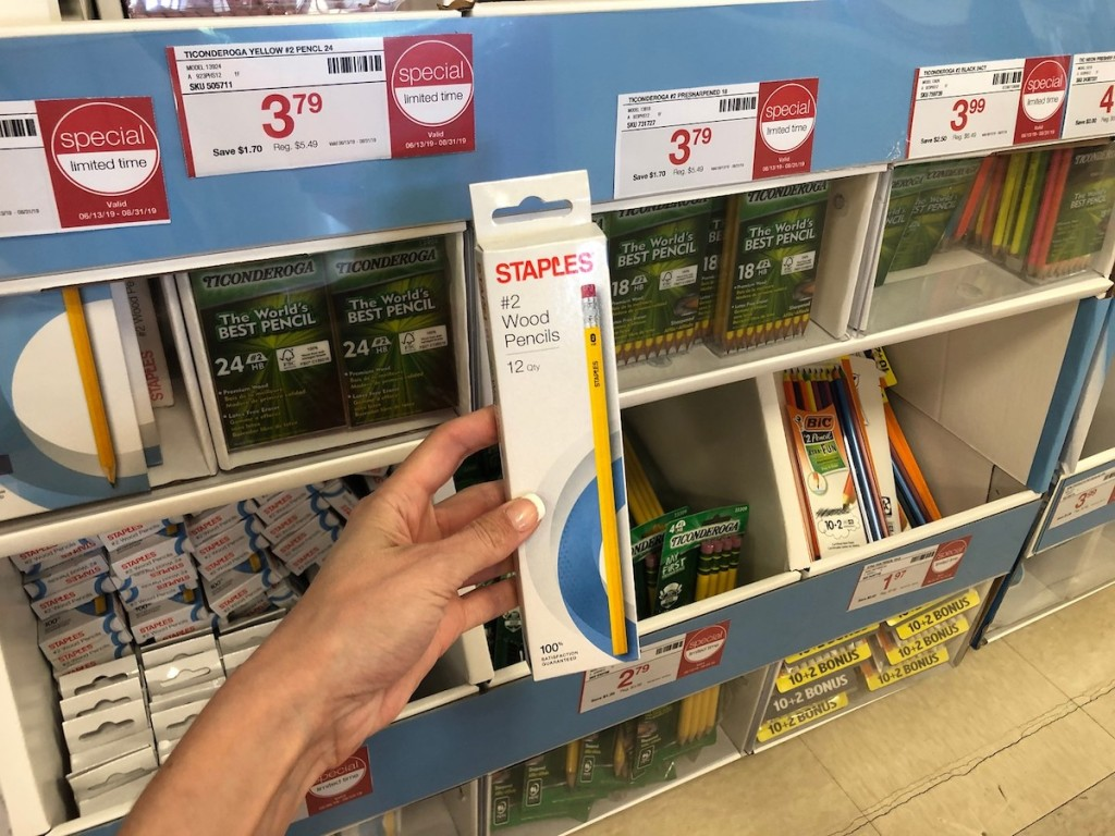 hand holding staples pencils in store