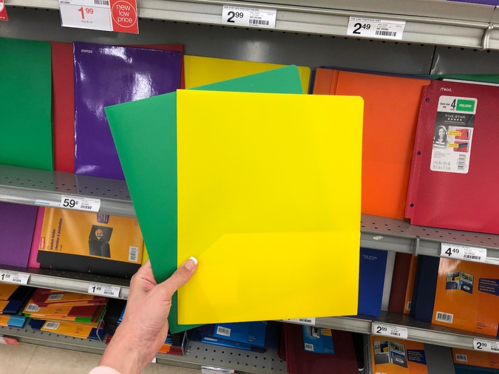 hand holding yellow and green poly folder