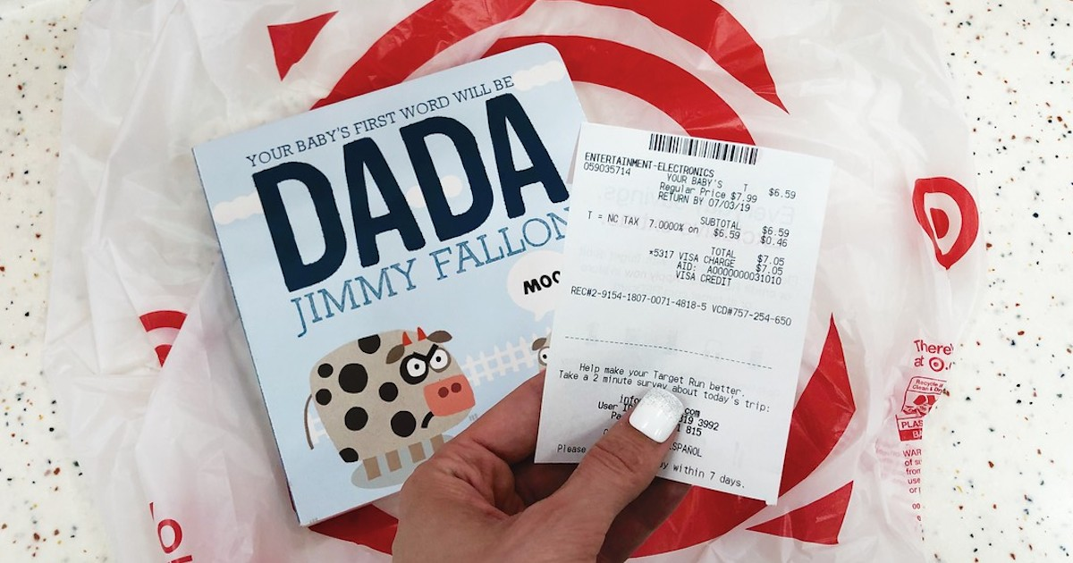 DADA book laying on target plastic bag with hand holding receipt