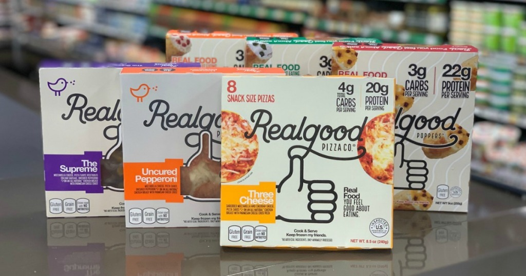 six realgood pizza boxes displayed on counter
