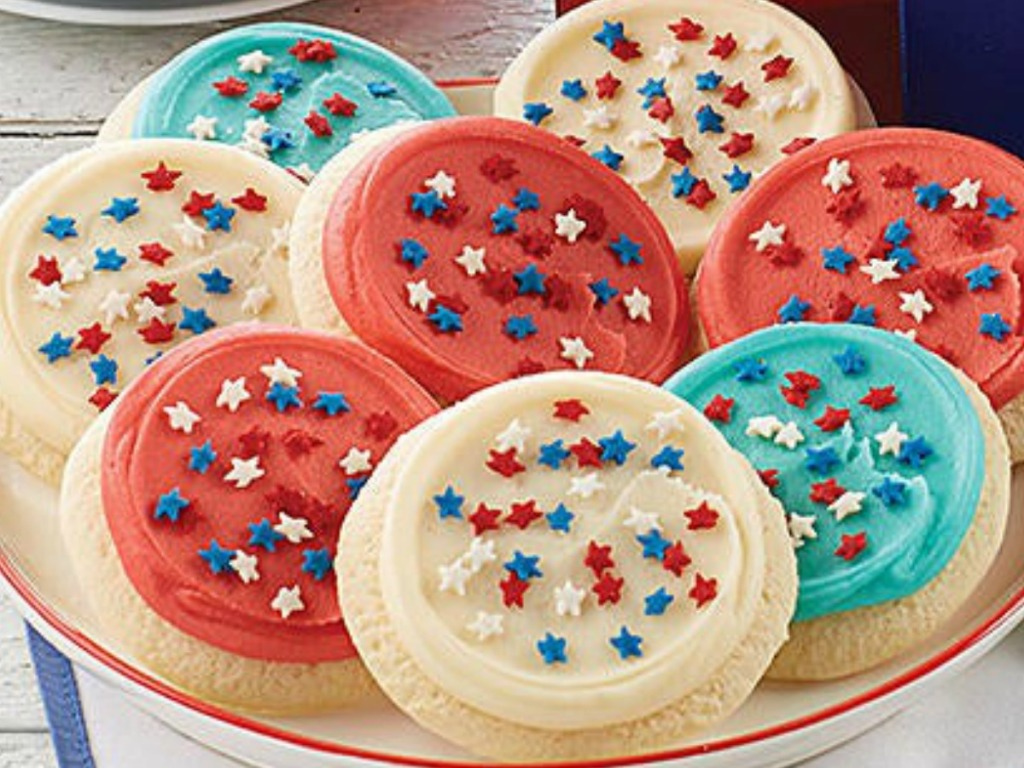 plate of red white and blue cookies with star sprinkles
