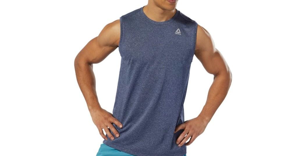 Man wearing men's workout Reebok tank