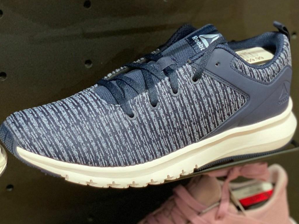 Reebok Women's Print Lux Shoes in navy on shelf in store