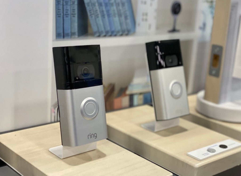 two silver ring doorbells on store display