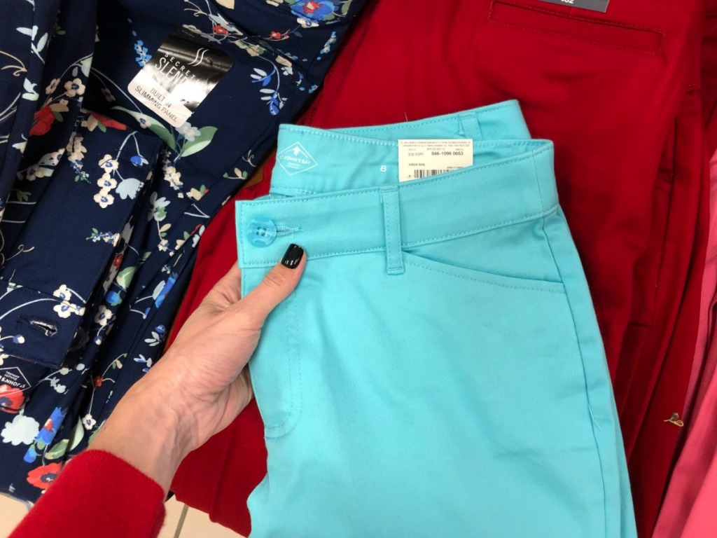 teal blue women's pants on a table of more pants