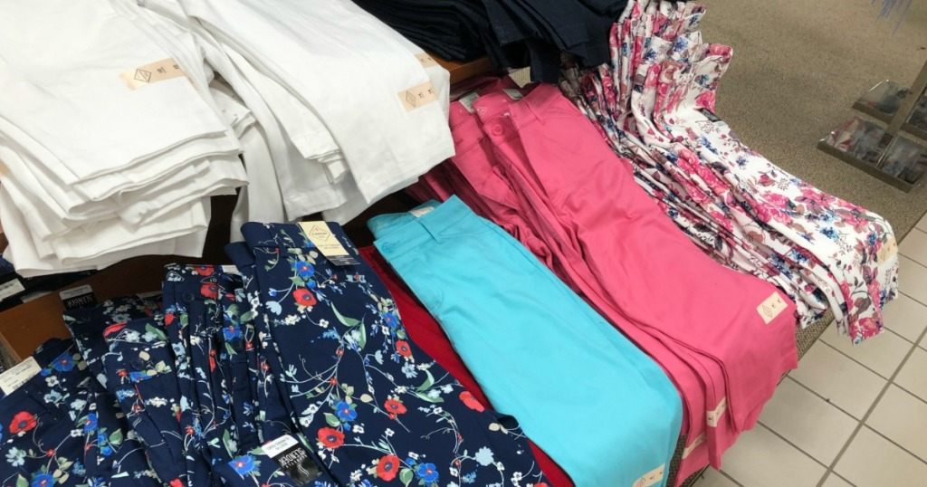 several colors of women's pants on a table