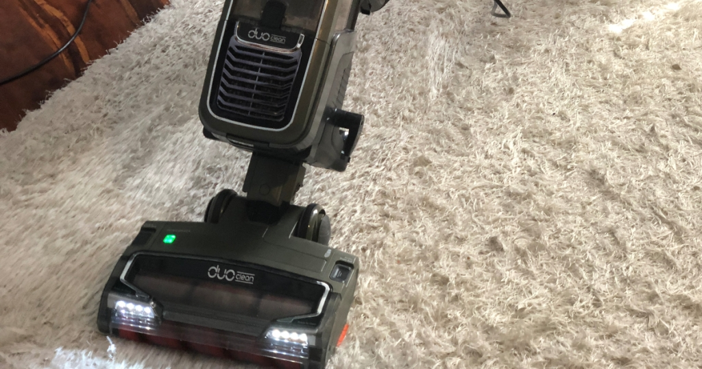 Shark Apex vacuum on white carpet