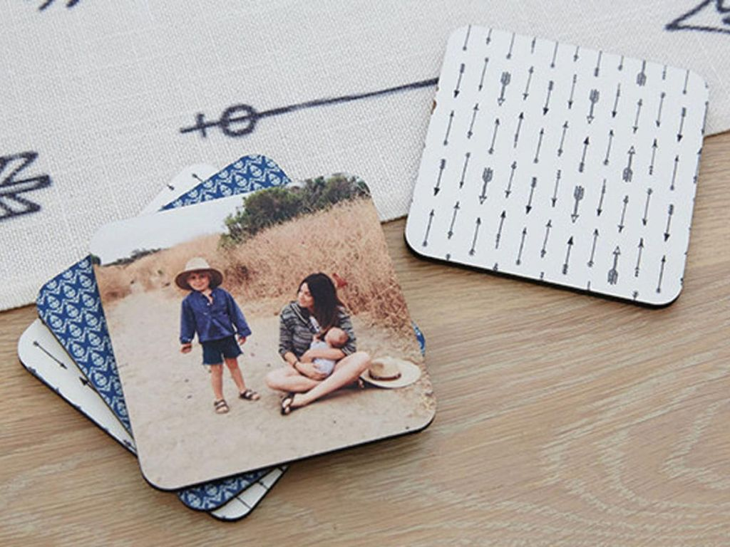 shutterfly coasters or woman holding a baby and young boy standing in the sand