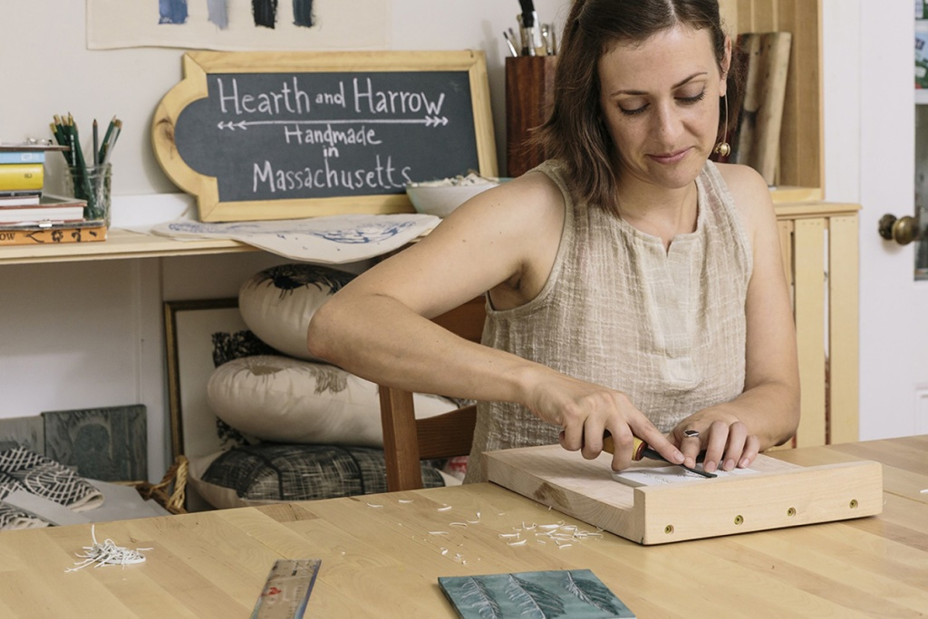 woman working on home decor for small business