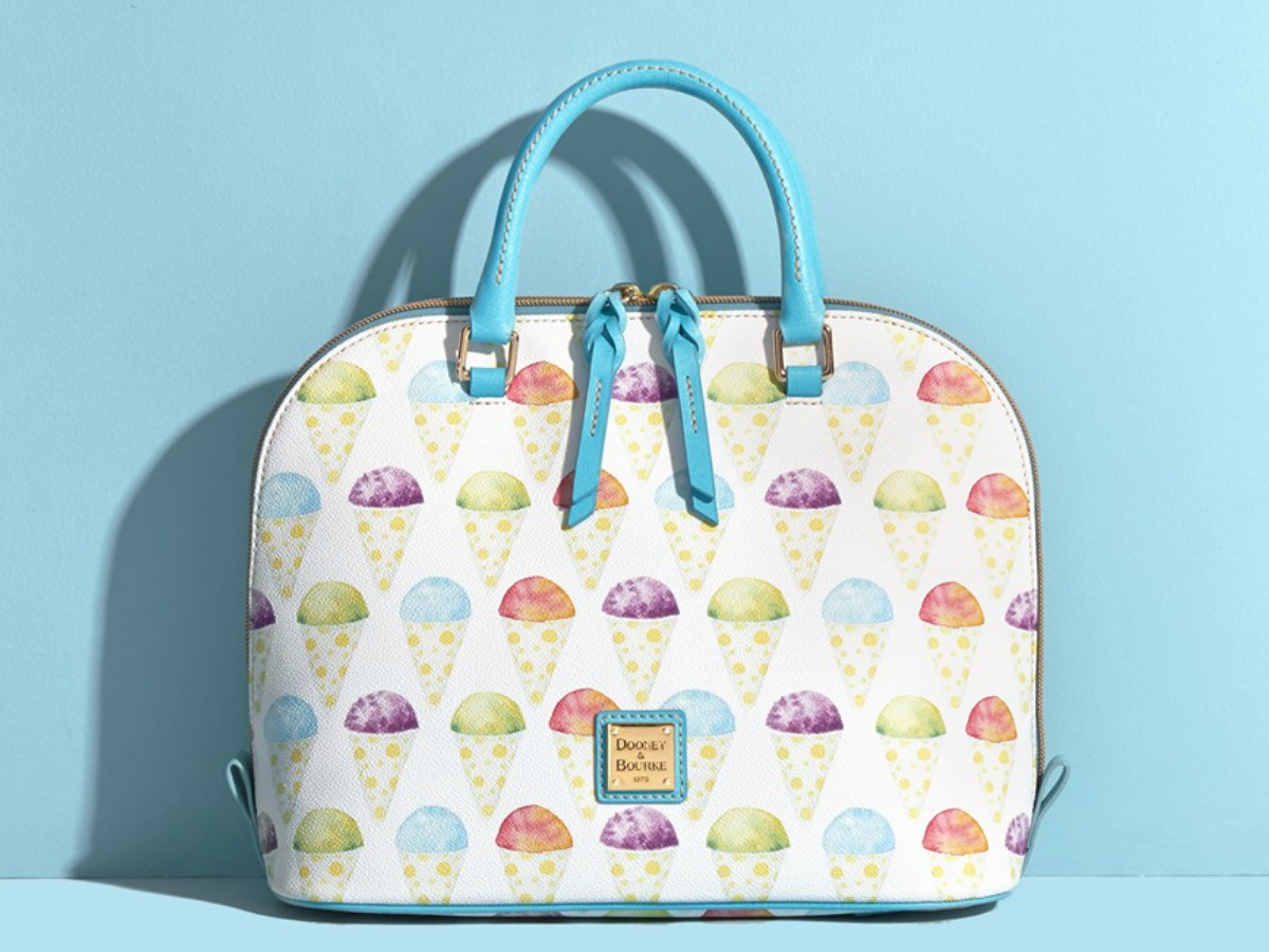 purse with snow cones on it on a blue background