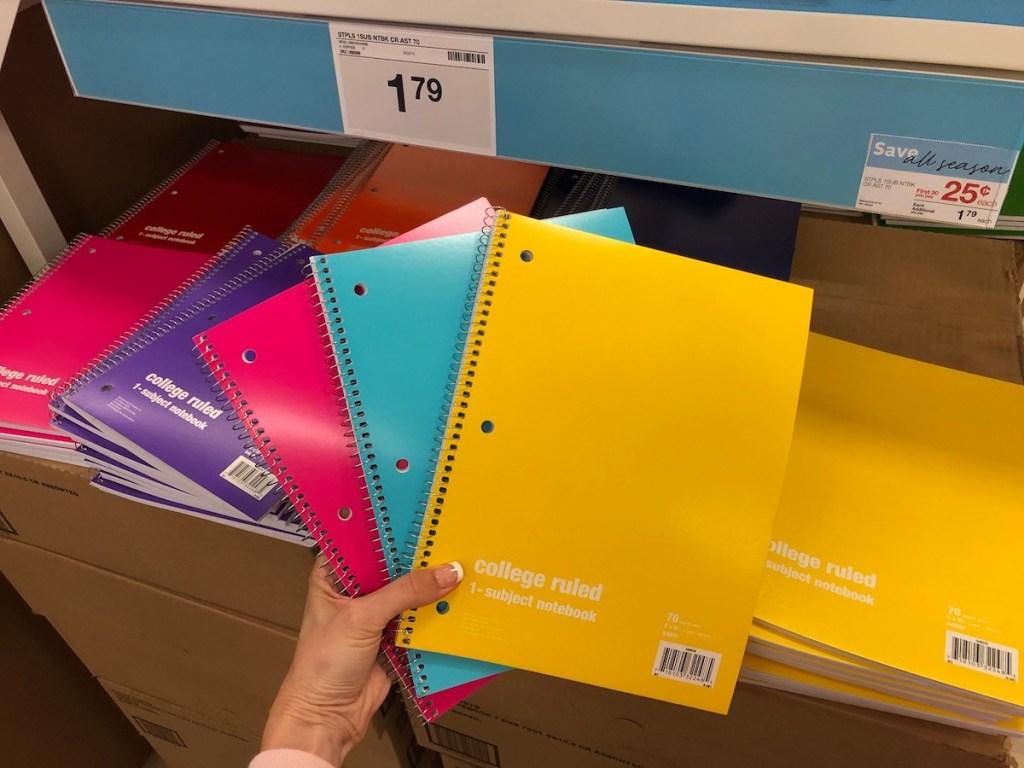 hand fanning spiral notebooks