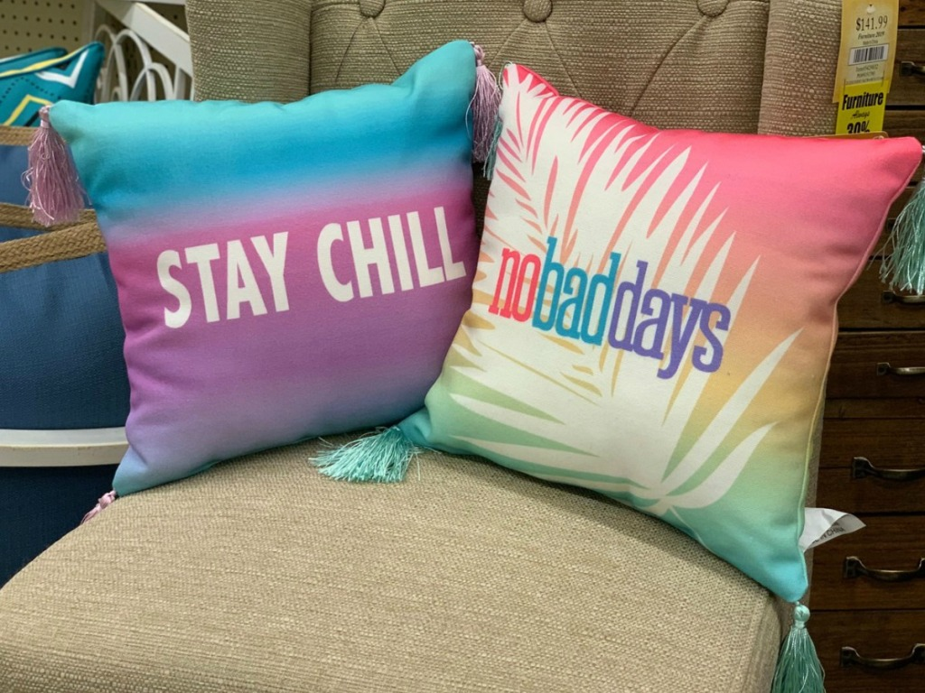 two colorful pillows on a chair