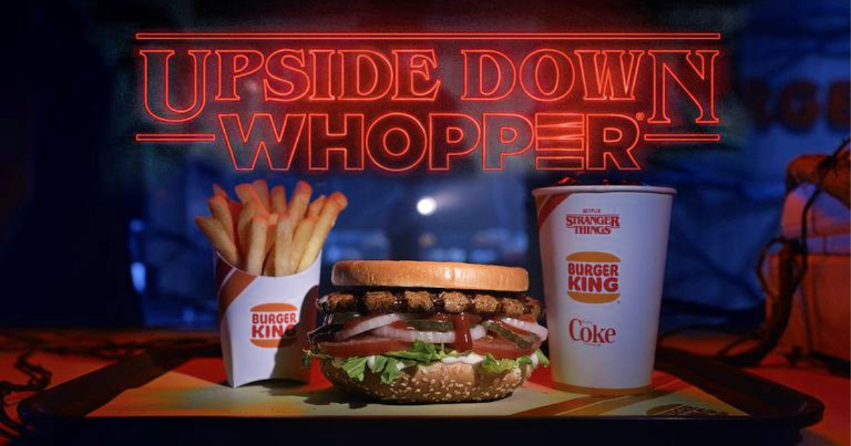 burger king upside down whopper, small fry, and small coke on tray with neon light sign