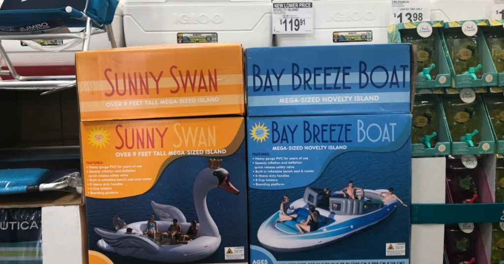 huge inflatable swan and boat in boxes at sam's club