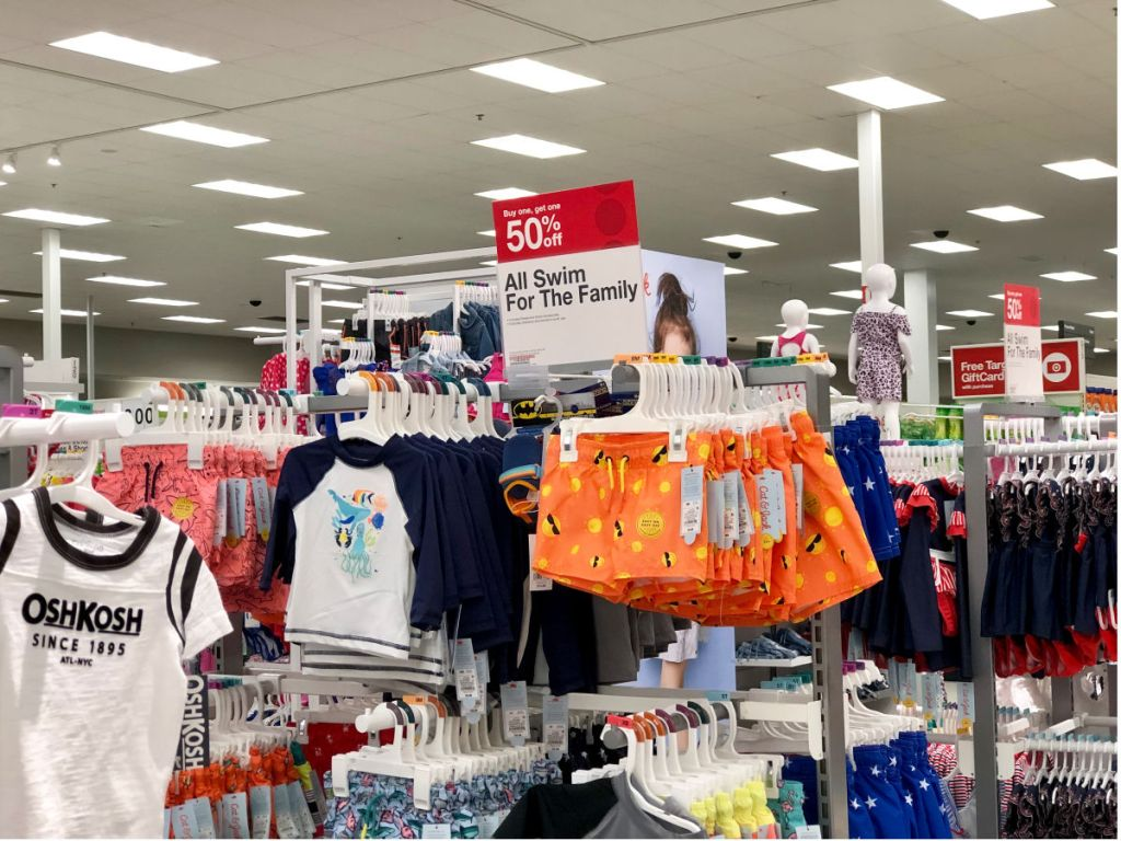 target boys orange swim trunks, white and navy rash guard