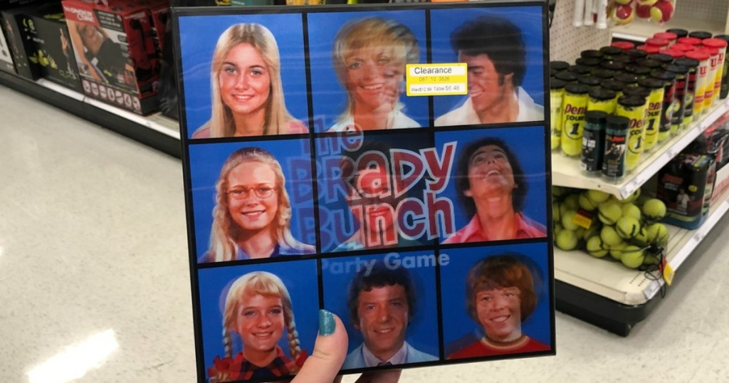 hand holding brady bunch game on clearance at target