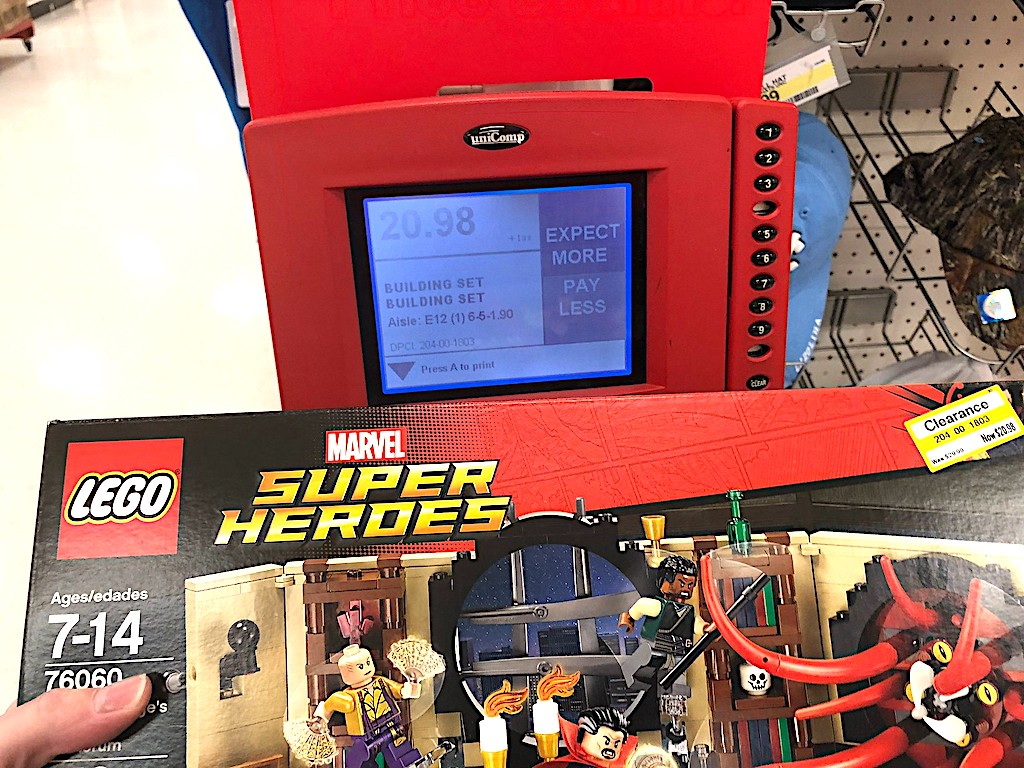 LEGO Marvel Super Heroes set next to red target price scanner