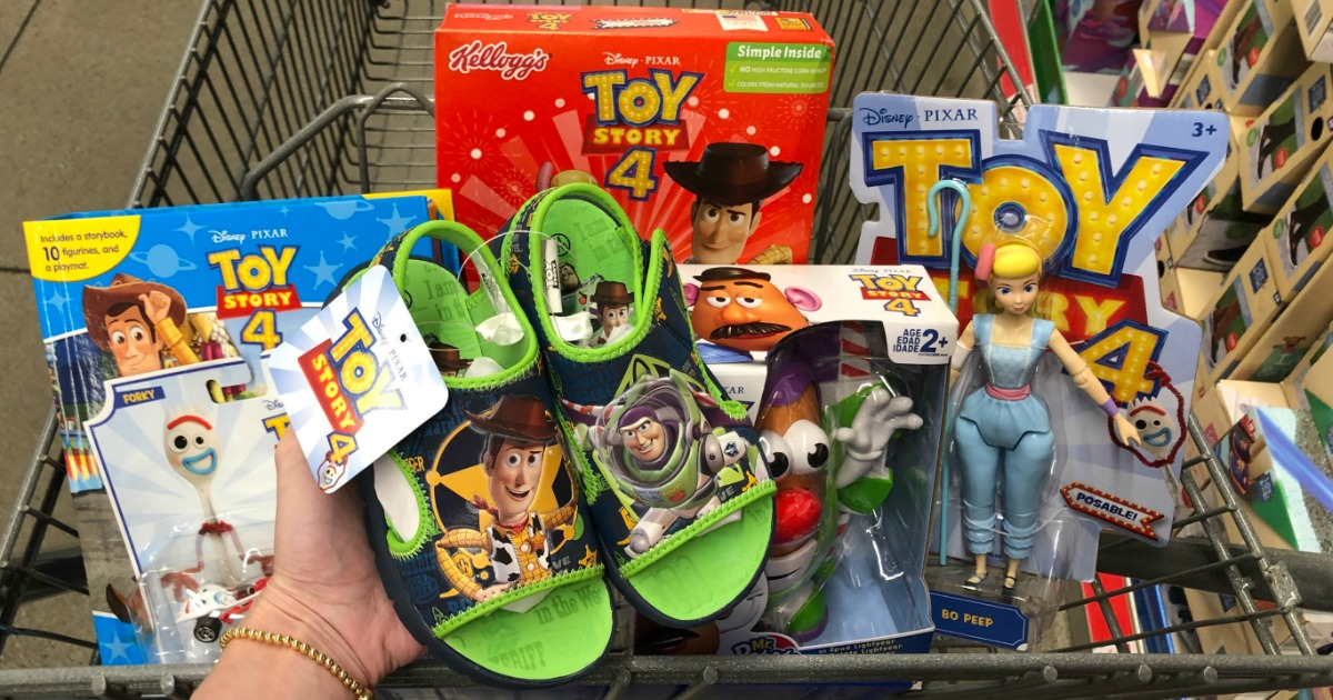 Woman holding pair of Toy Story 4 Children's Beach Sandals with other Toy Story items