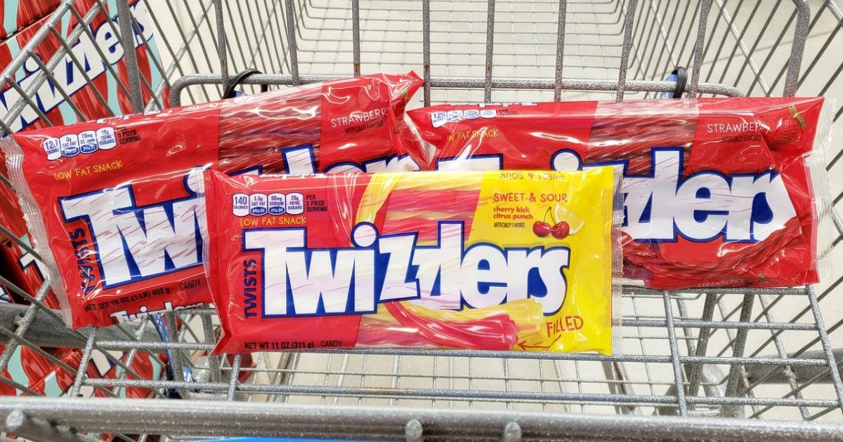 three bags of twizzlers candy in grocery cart