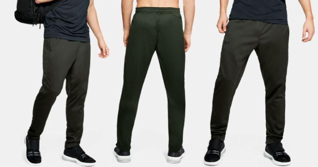 man wearing Under armour fleece pants in Artillery Green