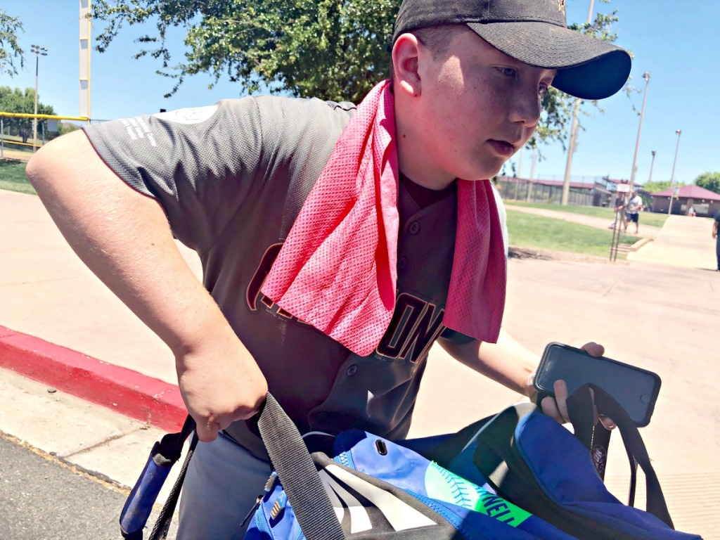 using a cooling towel to play baseball