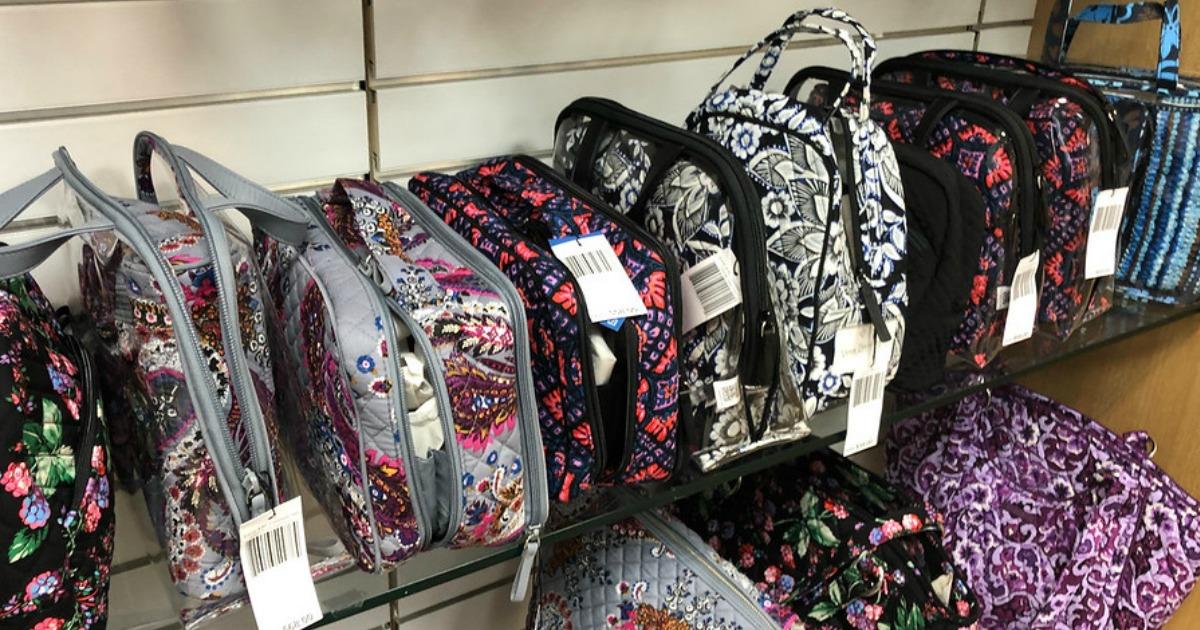 vera bradley travel bags displayed on store shelf
