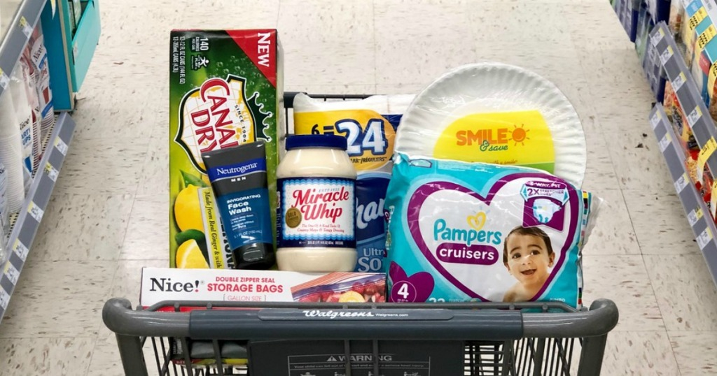 canada dry ginger ale and lemonade 12-packs, kraft miracle whip, and pampers cruisers diapers in cart at walgreens