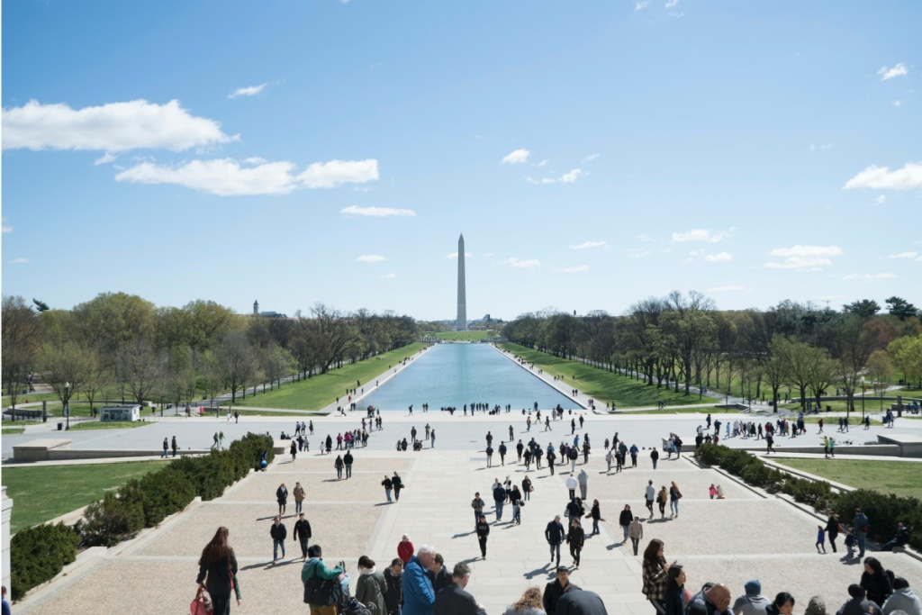 people walking in front of the washington monument