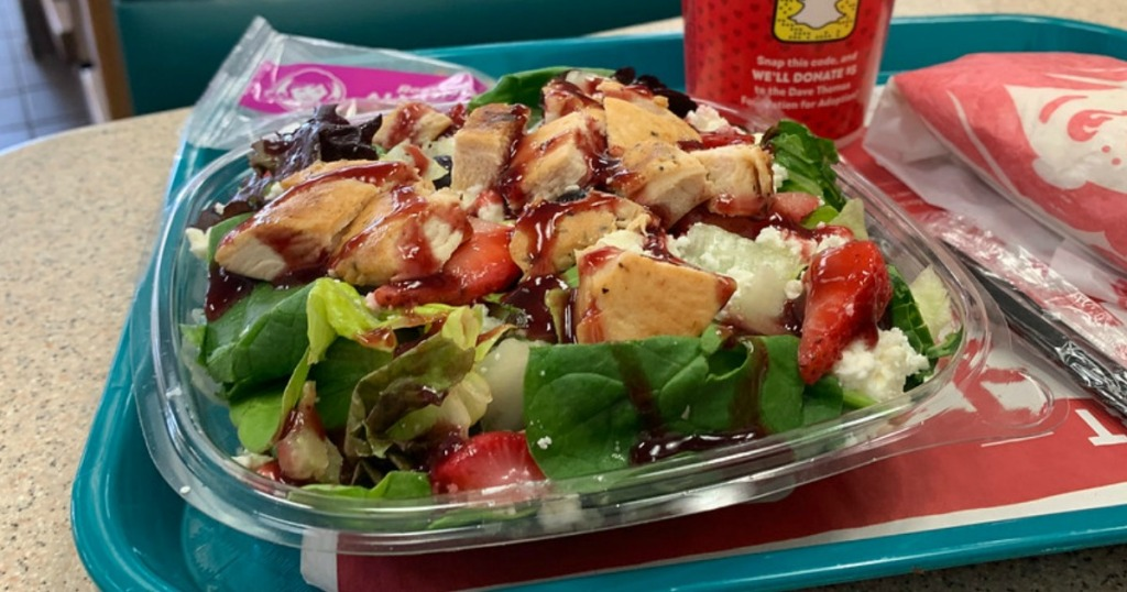 berry burst chicken salad sitting on a tray with a drink at wendy's