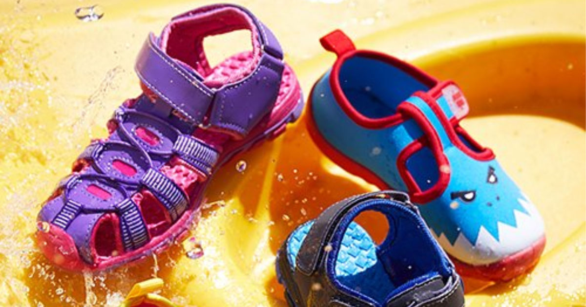 pink and purple jelly bean sandals and aquakiks shark themed sandals on orange background