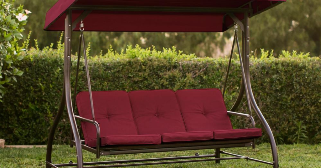 3-Seat Outdoor Canopy Swing with Convertible Flatbed Backrest in yard