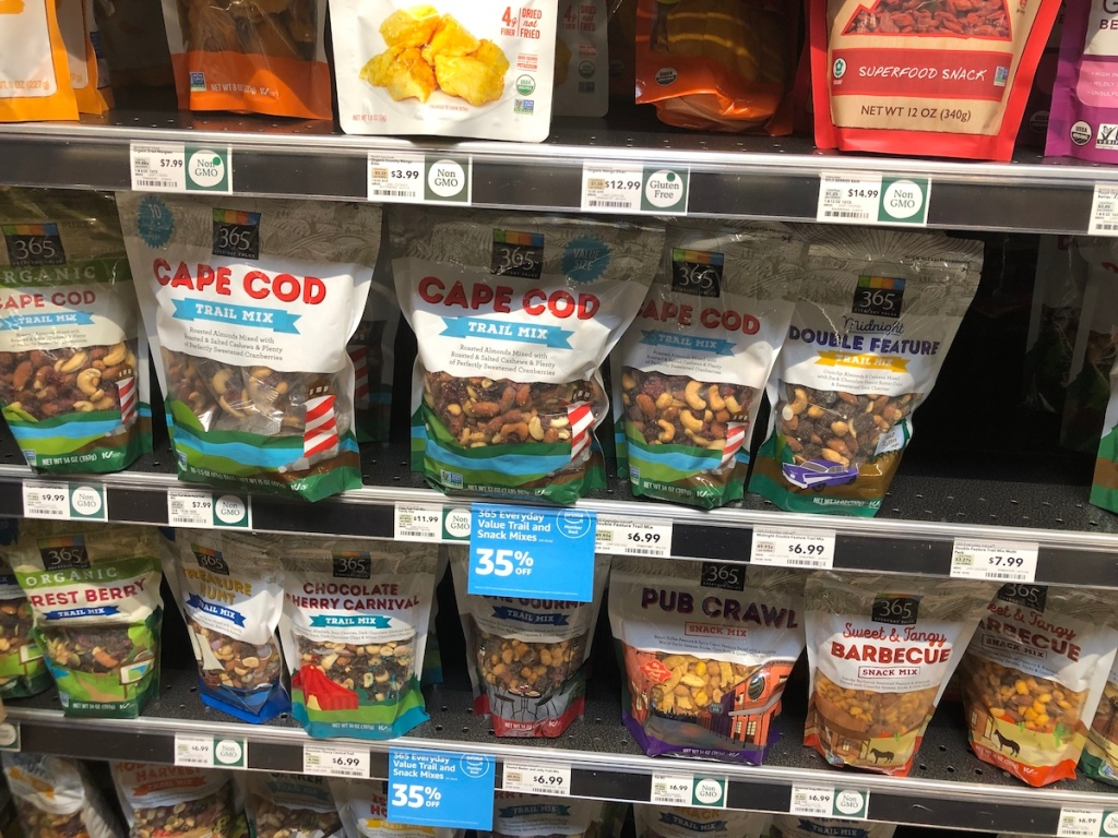 shelf of 365 Everyday Value Trail and Snack Mixes at whole foods