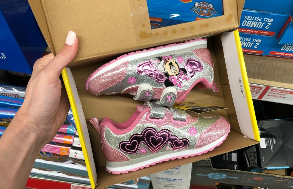 Minnie Mouse-themed kids athletic shoes in box at ALDI store