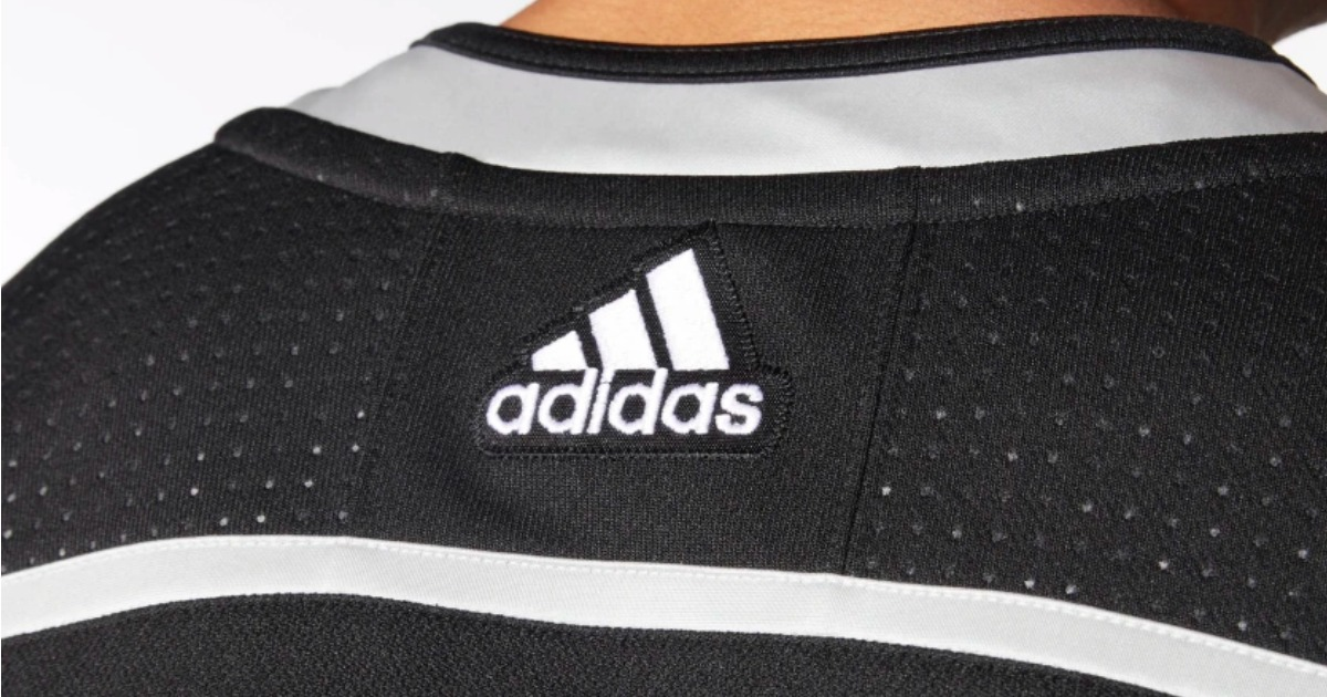 closeup of adidas logo on the back of a hockey jersey