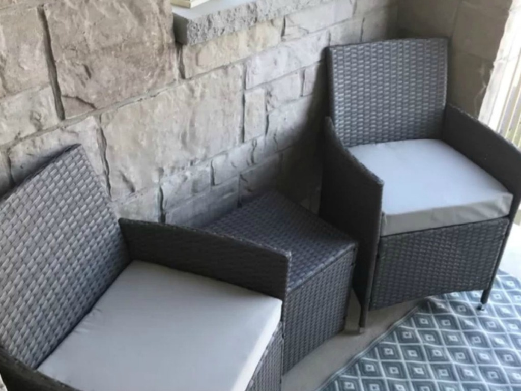 small patio with 2 grey chairs and little table