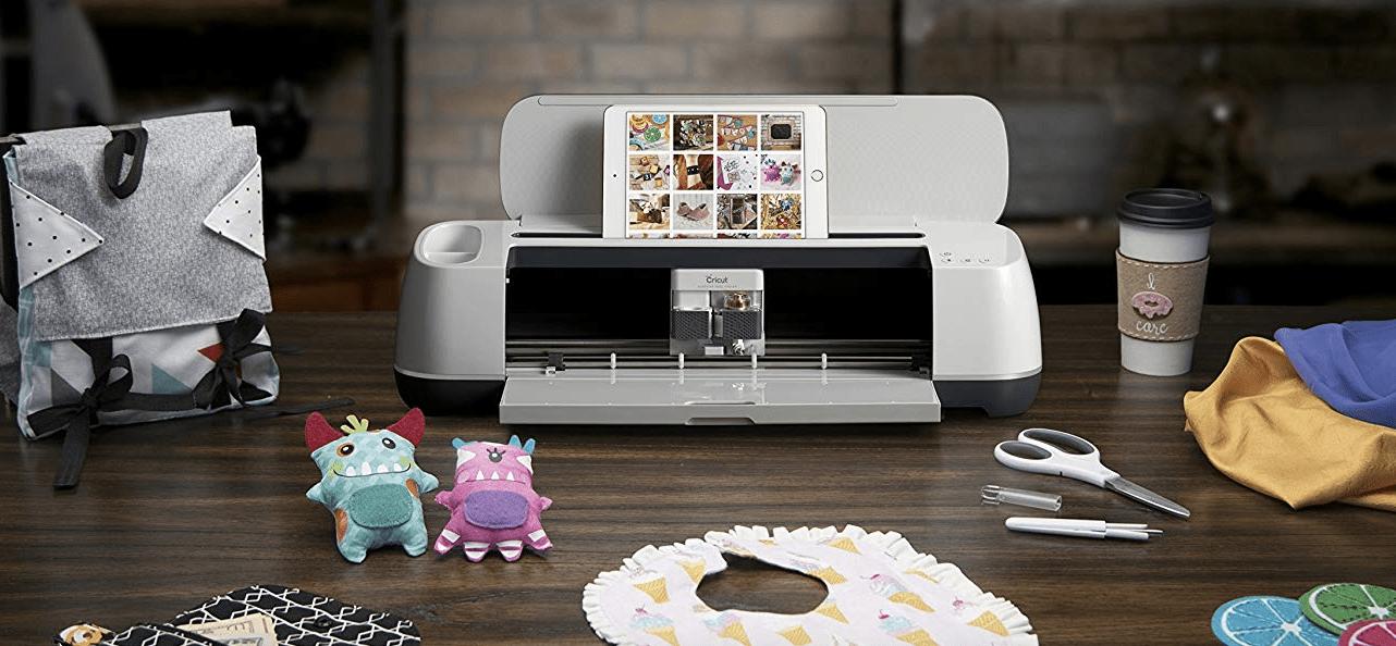 Cricut machine with accessories on desk