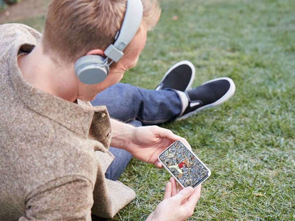 student watching game on phone