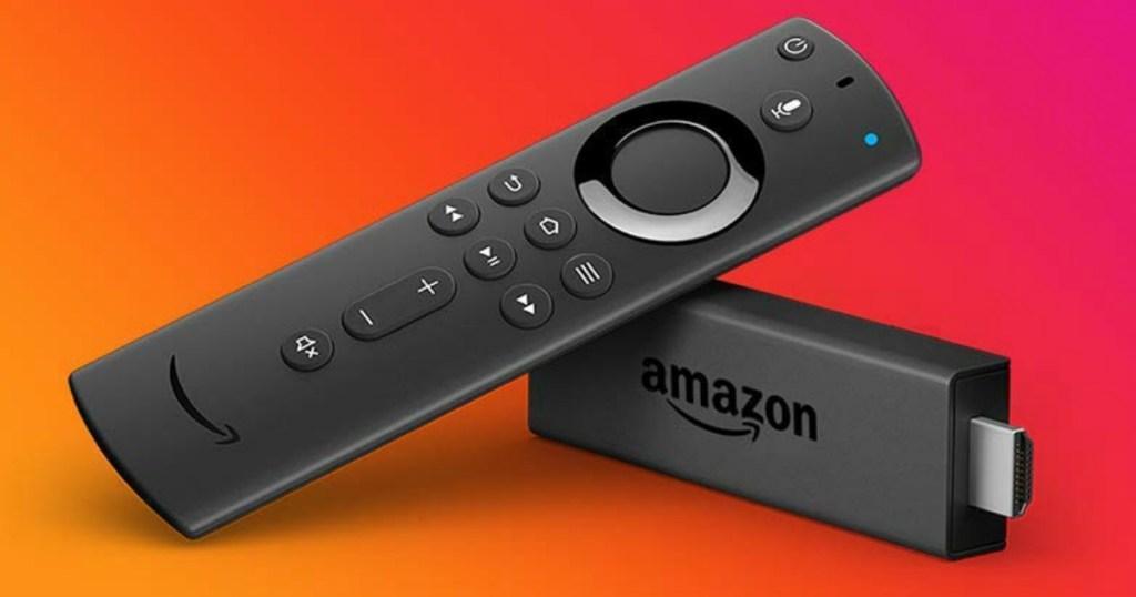 Amazon Fire TV Stick on orange background