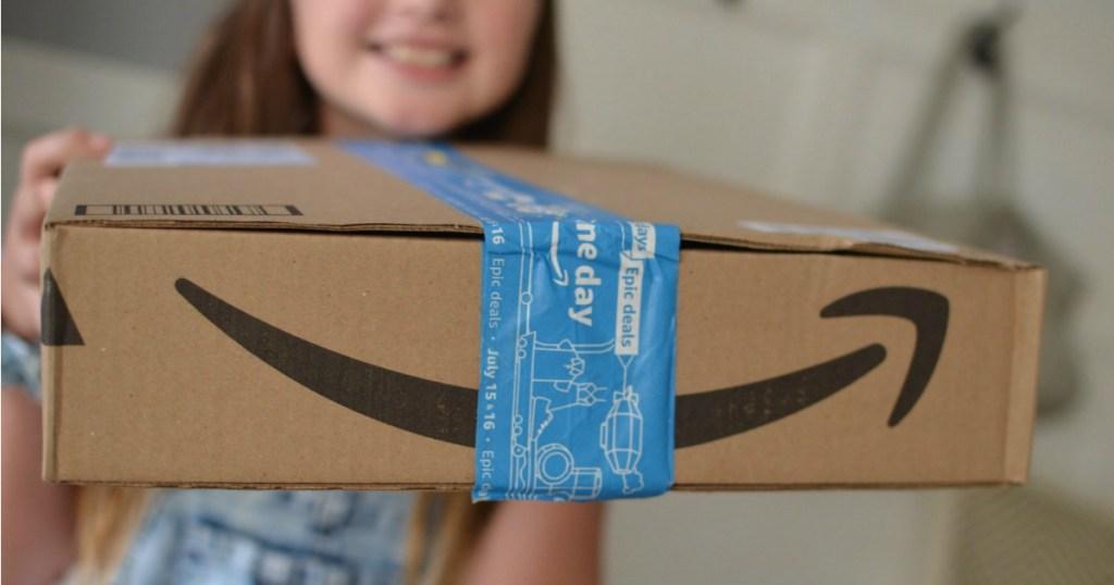 girl holding Amazon Prime Day 2019 Box