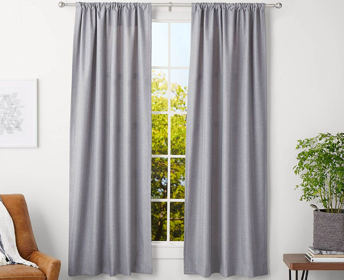 gray curtain and curtain rod hanging in living room